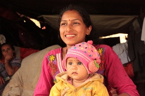 Sabita Acharya and her baby at her temporary home. ©UNFPA