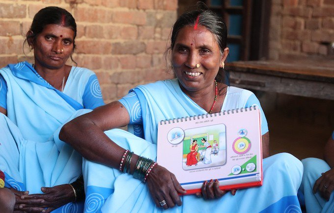 Local volunteers show Nepali families the benefits of voluntary family planning. ©UNFPA Nepal