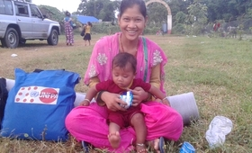 Ever since Bismati Tharu started living in a shared tent following the floods, she had no spare clothes to change for herself and her baby.  Photo: © UNFPA Nepal/Purna Nepali